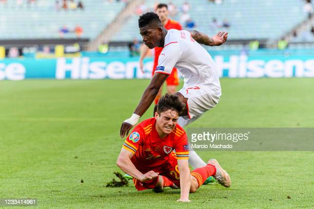 Daniel James of Wales is challenged by Breel Embolo of Switzerland during the UEFA Euro 2020 Championship Group A match between Wales and Switzerland...