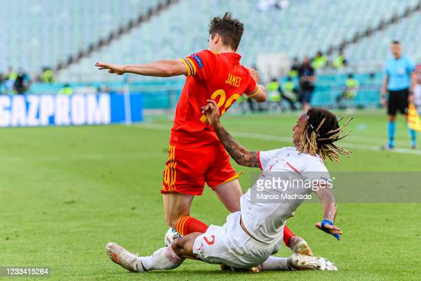 Daniel James of Wales is challenged by Kevin Mbabu of Switzerland during the UEFA Euro 2020 Championship Group A match between Wales and Switzerland...