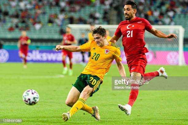 Daniel James of Wales is chased by Irfan Can Kahveci of Turkey during the UEFA Euro 2020 Championship Group A match between Turkey and Wales on June...