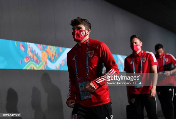 Daniel James of Wales is seen wearing a face mask as he arrives at the stadium prior to the UEFA Euro 2020 Championship Group A match between Italy...