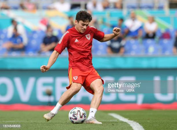 Daniel James of Wales makes a pass as he warms up prior to the UEFA Euro 2020 Championship Group A match between Italy and Wales at Olimpico Stadium...