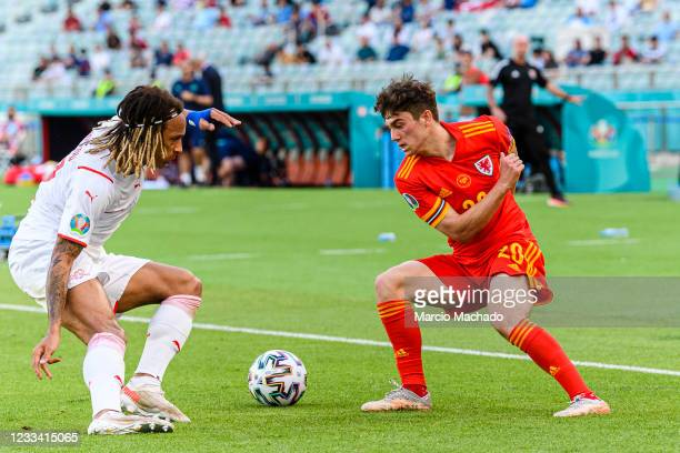 Daniel James of Wales plays against Kevin Mbabu of Switzerland during the UEFA Euro 2020 Championship Group A match between Wales and Switzerland on...