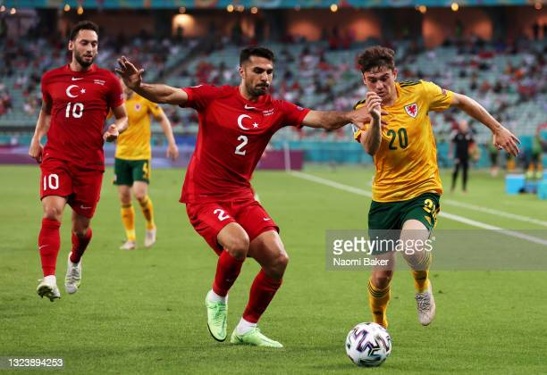Daniel James of Wales runs with the ball whilst under pressure from Zeki Celik of Turkey during the UEFA Euro 2020 Championship Group A match between...