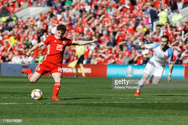 Daniel James of Wales scores the opening goal during the UEFA EURO 2020 Qualifier match between Wales and Slovakia at the Cardiff City Stadium on...