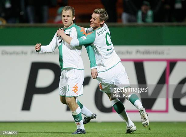 Daniel Jensen and Markus Rosenberg of Bremen celebrate their team's first goal during the Bundesliga match between Werder Bremen and Alemannia Aachen...