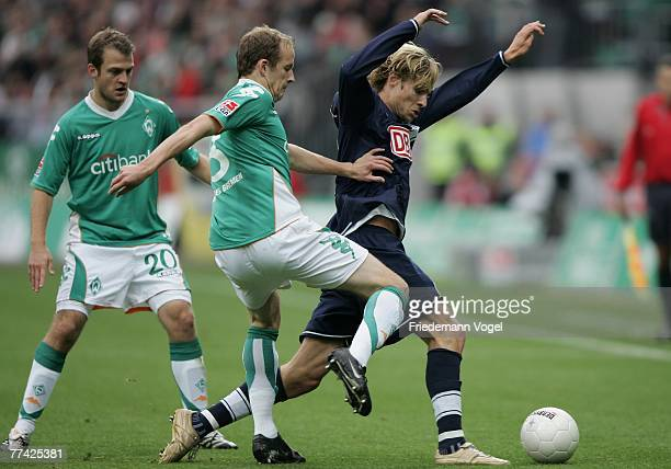 Daniel Jensen and Petri Pasanen of Bremen fights for the ball with Tobias Grahn during the Bundesliga match between Werder Bremen and Hertha BSC...