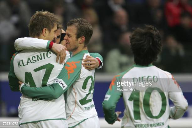 Daniel Jensen of Bremen celebrates with his team mates Ivan Klasnic and Miroslav Klose after scoring the third goal during the Bundesliga match...