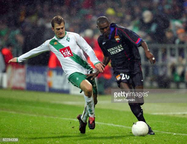 Daniel Jensen of Bremen in action against Eric Abidal of Lyon during The UEFA Champions League match between Werder Bremen and Olympique Lyonnais at...