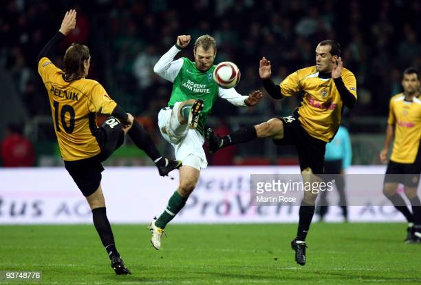 Daniel Jensen of Bremen, Nejc Pecnik and Ruben Micael of Funchal compete for the ball during the UEFA Europa League Group L match between Werder...