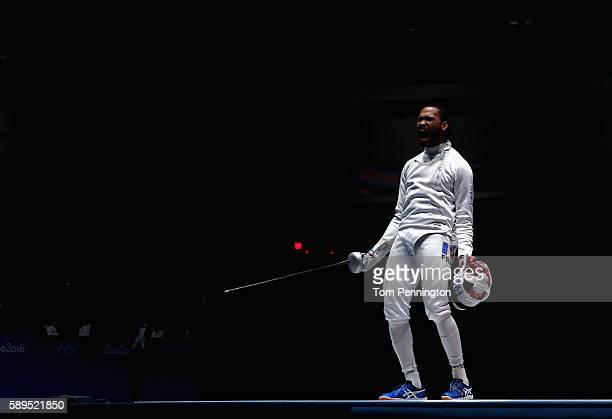 Daniel Jerent of France reacts against Marco Fichera of Italy during the Men's Epee Team Gold Medal Match on Day 9 of the Rio 2016 Olympic Games at...