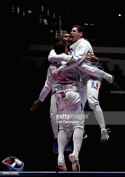 Daniel Jerent, Yannick Borel and Jean-Michel Lucenay of France celebrate winning the gold medal after the Men's Epee Team Gold Medal Match against...