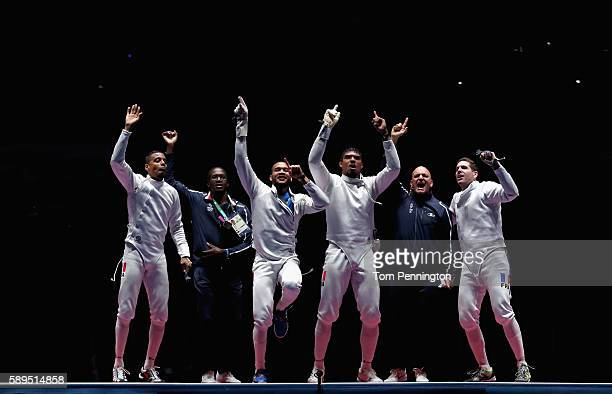 Daniel Jerent Yannick Borel JeanMichel Lucenay and Gauthier Grumier of France celebrate winning the gold medal after the Men's Epee Team Gold Medal...