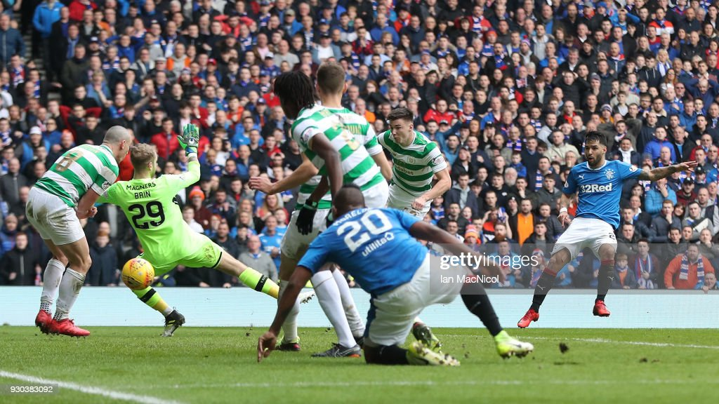 Daniel Joao Santos Candeias of Rangers scores his sides second goal past Scott Bain of Celtic during the Ladbrokes Scottish Premiership match between Rangers and Celtic at Ibrox Stadium on March 11, 2018 in Glasgow, Scotland.
