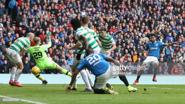 Daniel Joao Santos Candeias of Rangers scores his sides second goal past Scott Bain of Celtic during the Ladbrokes Scottish Premiership match between...