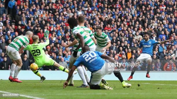 Daniel Joao Santos Candeias of Rangers scores his sides second goal past Scott Bain of Celtic during the Ladbrokes Scottish Premiership match between...