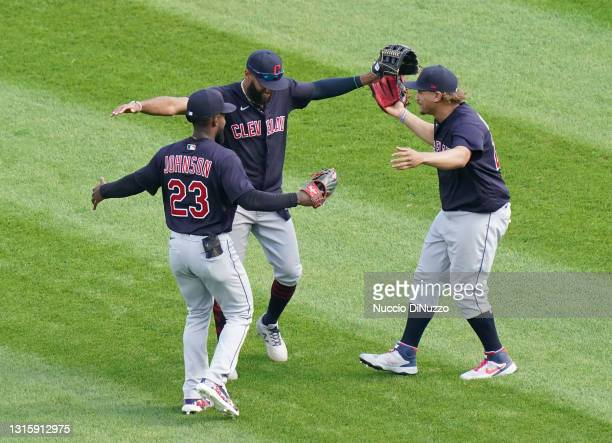 Daniel Johnson, Amed Rosario and Josh Naylor of the Cleveland Indians celebrate after their team's win over the Chicago White Sox at Guaranteed Rate...