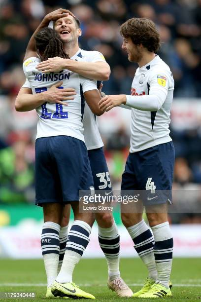 Daniel Johnson of Preston North End celebrates with teammates David Nugent and Ben Pearson after scoring his sides opening goal during the Sky Bet...