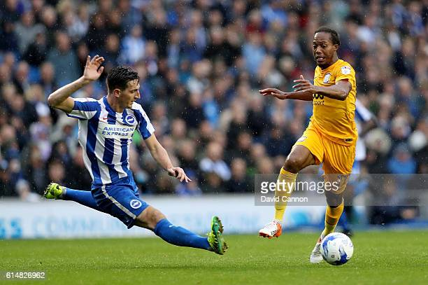 Daniel Johnson of Preston North End is tackled by Lewis Dunk of Brighton and Hove Albion during the Sky Bet Championship match between Brighton &...
