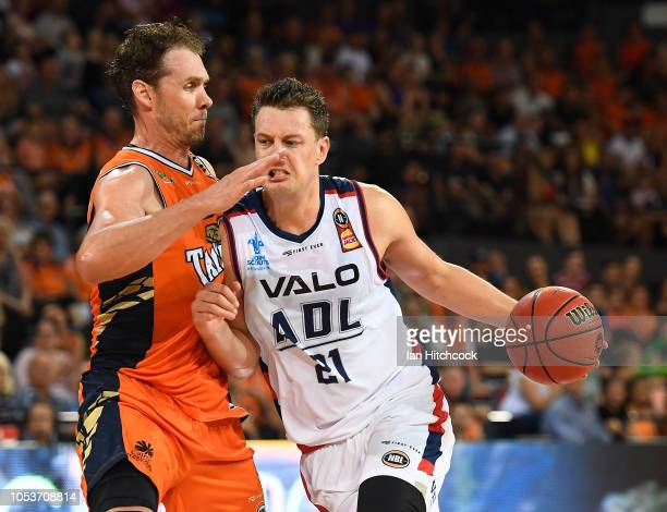 Daniel Johnson of the 36ers drives to the basket past Alex Loughton of the Taipans during the round three NBL match between the Cairns Taipans and...