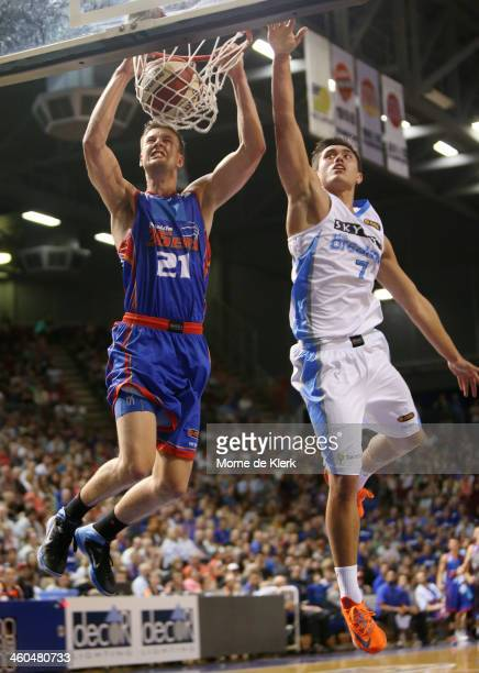 Daniel Johnson of the 36ers dunks the ball under pressure from Brendan Teys of the Breakers during the round 12 NBL match between the Adelaide 36ers...