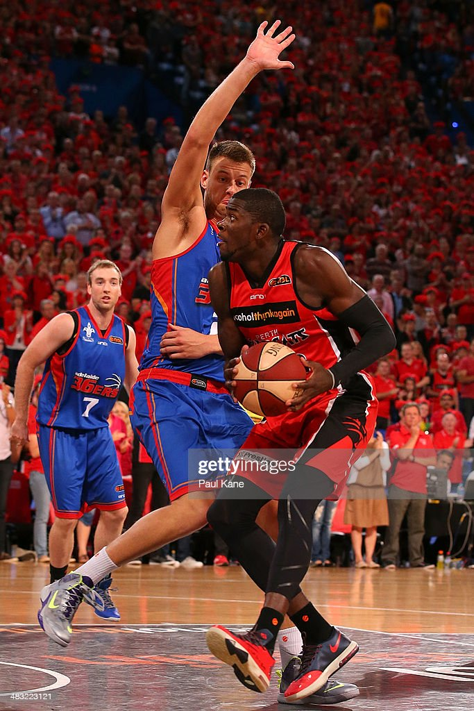 Daniel Johnson of the 36ers sets to block James Ennis of the Wildcats during game one of the NBL Grand Final series between the Perth Wildcats and the Adelaide 36ers at Perth Arena on April 7, 2014 in Perth, Australia.