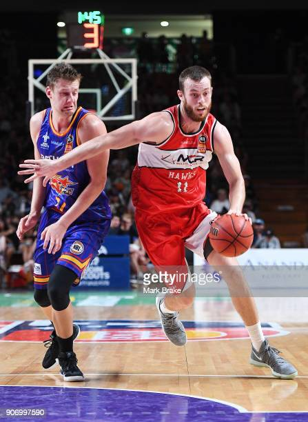 Daniel Johnson of the Adelaide 36ers and Nicholas Kay of the Illawarra Hawks during the round 15 NBL match between the Adelaide 36ers and the...