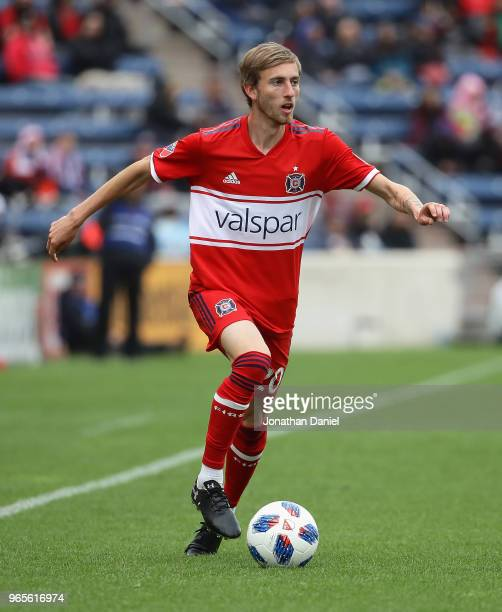 Daniel Johnson of the Chicago Fire looks to pass against the Houston Dynamo at Toyota Park on May 20 2018 in Bridgeview Illinois The Dynamo defeated...