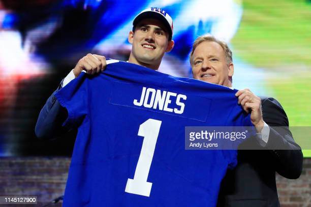 Daniel Jones of Duke poses with NFL Commissioner Roger Goodell after being chosen overall by the New York Giants during the first round of the 2019...