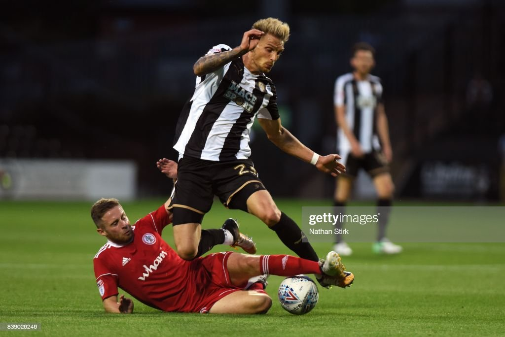 Daniel Jones of Notts County is tackled by Jordan Clark of Accrington Stanley during the Sky Bet League Two match between Notts County and Accrington Stanley at Meadow Lane on August 25, 2017 in Nottingham, England.