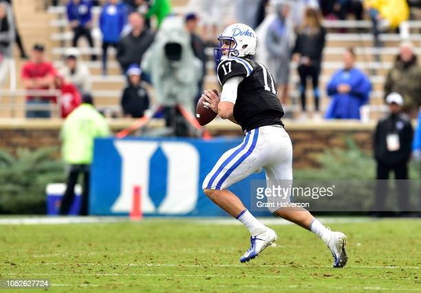 Daniel Jones of the Duke Blue Devils drops back to pass against the Virginia Cavaliers during their game at Wallace Wade Stadium on October 20 2018...