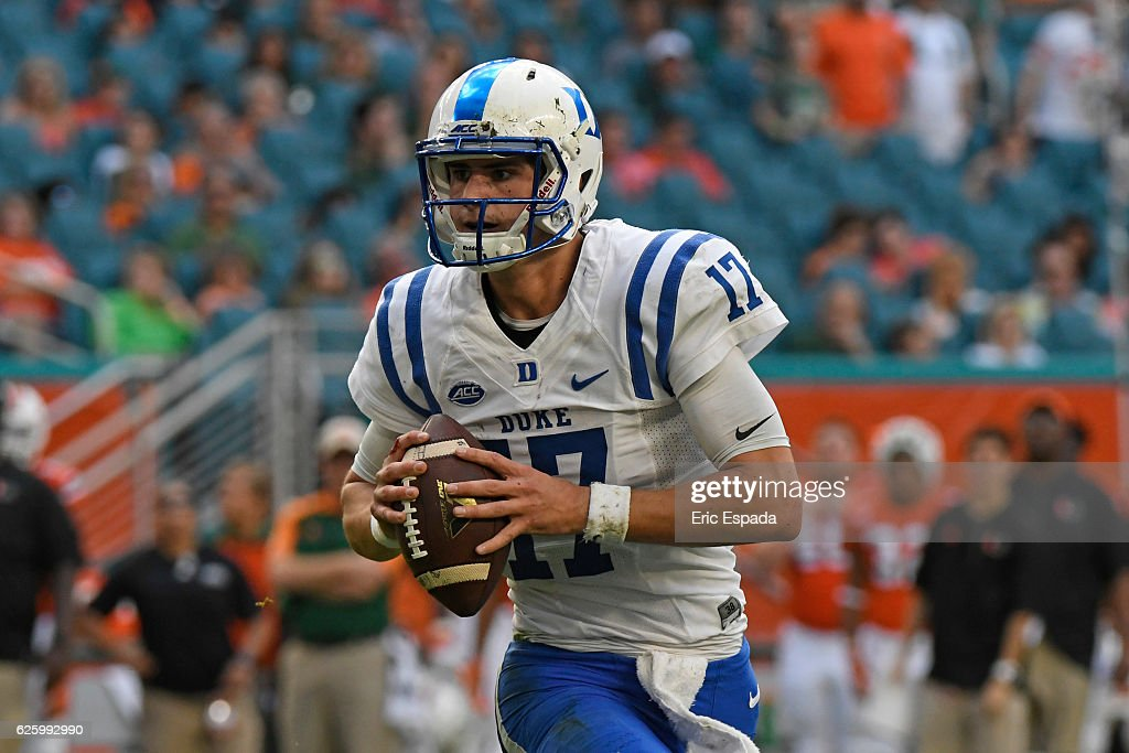Daniel Jones #17 of the Duke Blue Devils rolls out during the first quarter against the Miami Hurricanes at Hard Rock Stadium on November 26, 2016 in Miami Gardens, Florida.