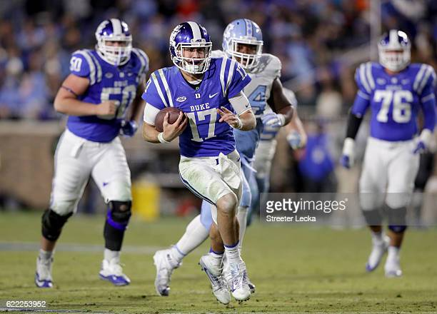 Daniel Jones of the Duke Blue Devils runs with the ball against the North Carolina Tar Heels during their game at Wallace Wade Stadium on November 10...