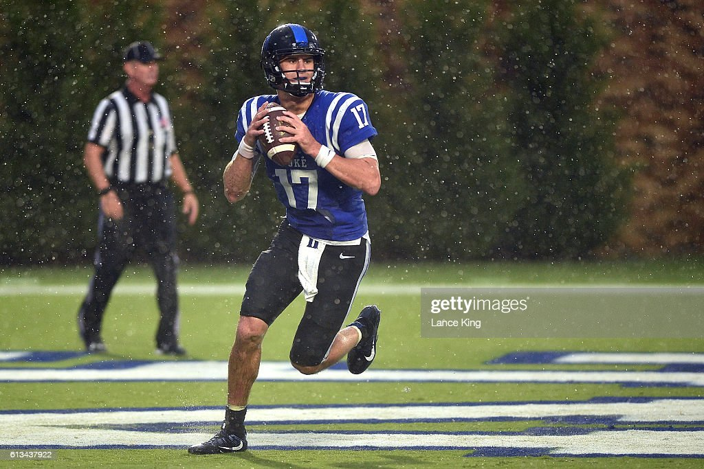 Daniel Jones #17 of the Duke Blue Devils scrambles out of the pocket in the end zone during their game against the Army Black Knights at Wallace Wade Stadium on October 8, 2016 in Durham, North Carolina.