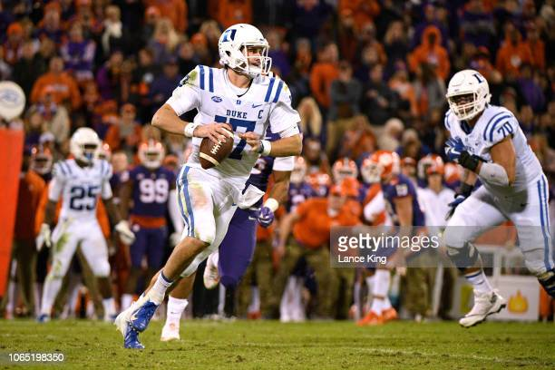 Daniel Jones of the Duke Blue Devils scrambles out of the pocket against the Clemson Tigers at Clemson Memorial Stadium on November 17 2018 in...