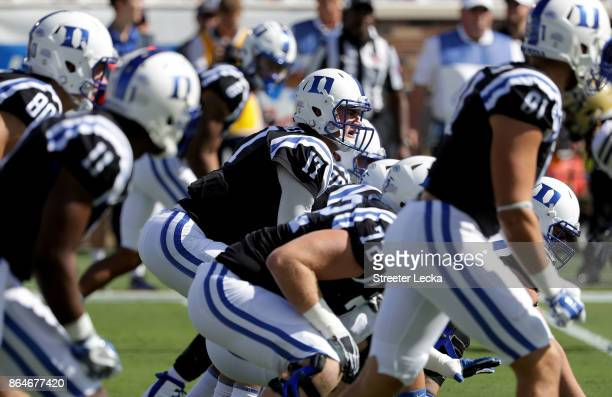 Daniel Jones of the Duke Blue Devils stands behind his offensive line against the Pittsburgh Panthers during their game at Wallace Wade Stadium on...