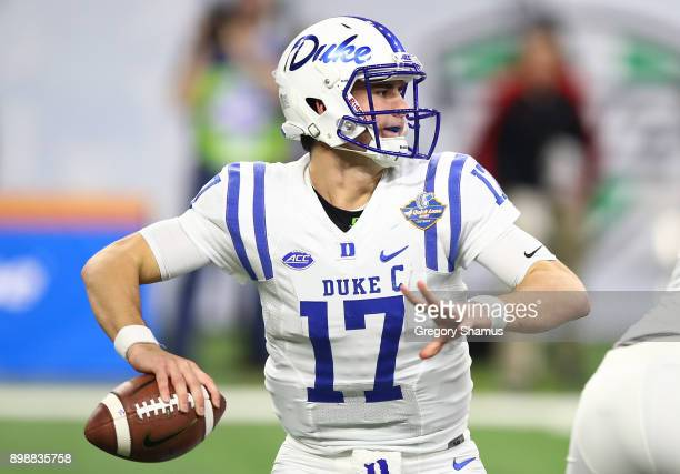 Daniel Jones of the Duke Blue Devils throws a first half pass while playing the Northern Illinois Huskies during the Quick Lane Bowl at Ford Field on...