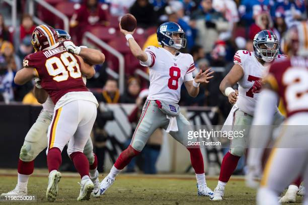 Daniel Jones of the New York Giants attempts a pass during the second half of the game against the Washington Redskins at FedExField on December 22,...
