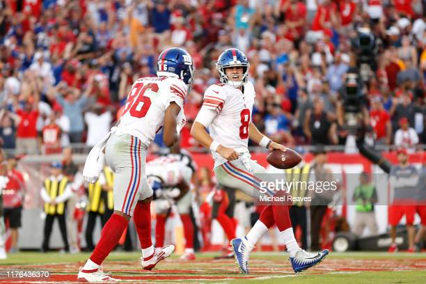 Daniel Jones of the New York Giants celebrates after scoring a touchdown against the Tampa Bay Buccaneers during the fourth quarter at Raymond James...