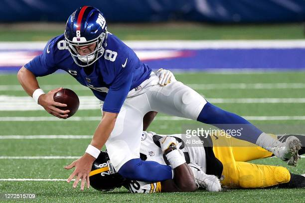 Daniel Jones of the New York Giants gets sacked by Mike Hilton of the Pittsburgh Steelers during the fourth quarter in the game at MetLife Stadium on...