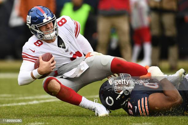 Daniel Jones of the New York Giants is brought down by Nick Williams of the Chicago Bears during a game at Soldier Field on November 24 2019 in...