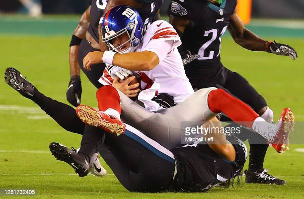 Daniel Jones of the New York Giants is tackled by Alex Singleton of the Philadelphia Eagles during the second quarter at Lincoln Financial Field on...