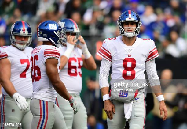 Daniel Jones of the New York Giants looks on after throwing an incomplete pass in the first half of their game against the New York Jets at MetLife...