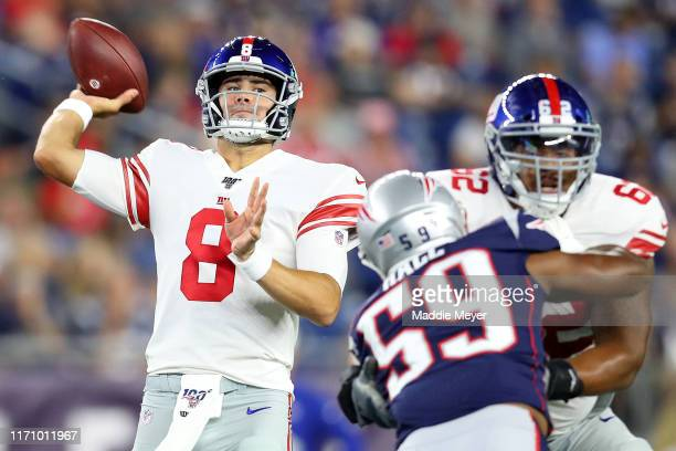 Daniel Jones of the New York Giants makes a pass during the preseason game between the New York Giants and the New England Patriots at Gillette...