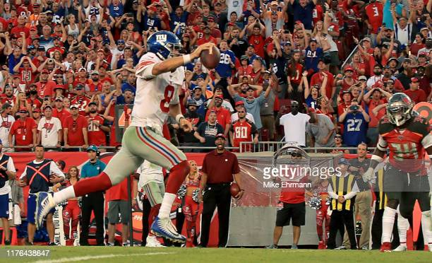 Daniel Jones of the New York Giants scores a 4th quarter touchdown during a game against the Tampa Bay Buccaneers at Raymond James Stadium on...