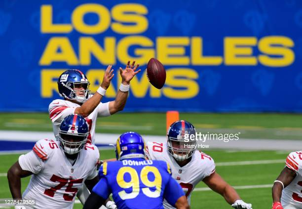 Daniel Jones of the New York Giants takes a snap during the first half against the Los Angeles Rams at SoFi Stadium on October 04 2020 in Inglewood...