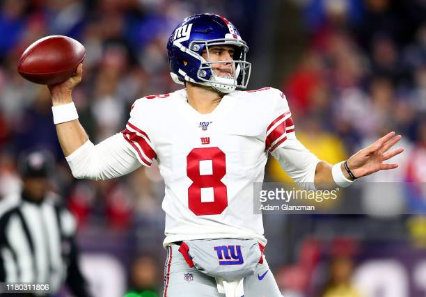 Daniel Jones of the New York Giants throws a pass against the New England Patriots during the first quarter in the game at Gillette Stadium on...