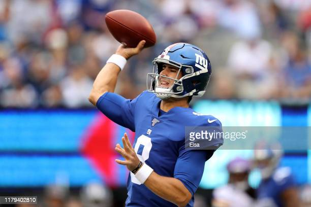 Daniel Jones of the New York Giants throws a pass against the Minnesota Vikings during the first quarter in the game at MetLife Stadium on October 06...