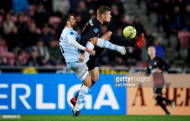 Daniel Jorgensen of FC Helsingor and Alexander Sorloth of FC Midtjylland compete for the ball during the Danish Alka Superliga match between FC...