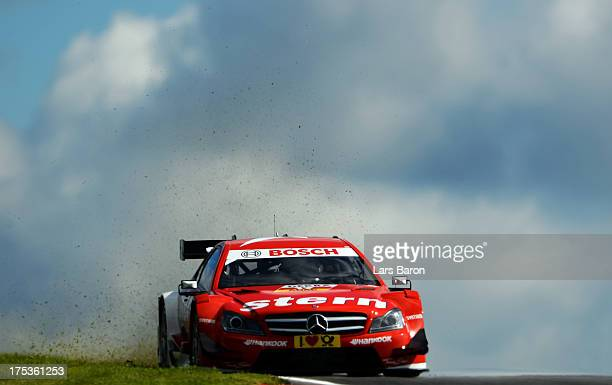 Daniel Juncadella of Spain and stern Mercedes AMG drives during the training session ahead of qualifying for the sixth round of the DTM 2013 German...
