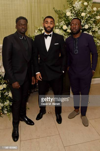 Daniel Kaluuya Anthony Welsh and guest attend the British Vogue and Tiffany Co Fashion and Film Party at Annabel's on February 2 2020 in London...